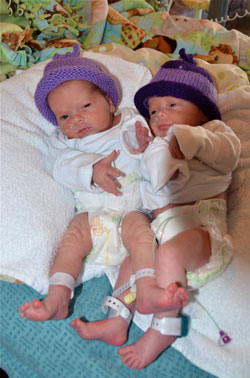 Babies wearing purple caps